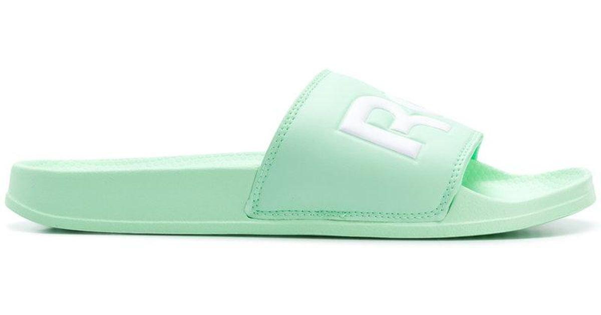 c7904313bfb8 Lyst - Reebok Split Logo Slides in Green for Men
