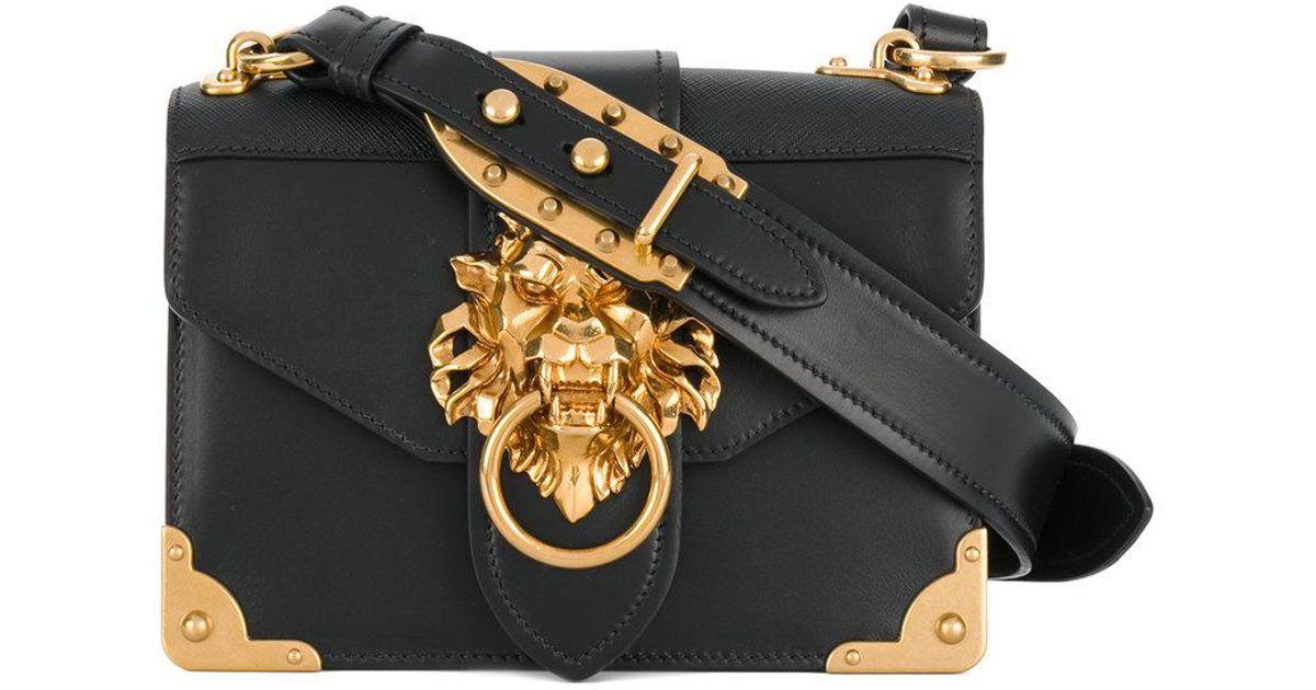 7668be641de8 Prada Cahier Lion-embellished Shoulder Bag in Black - Lyst