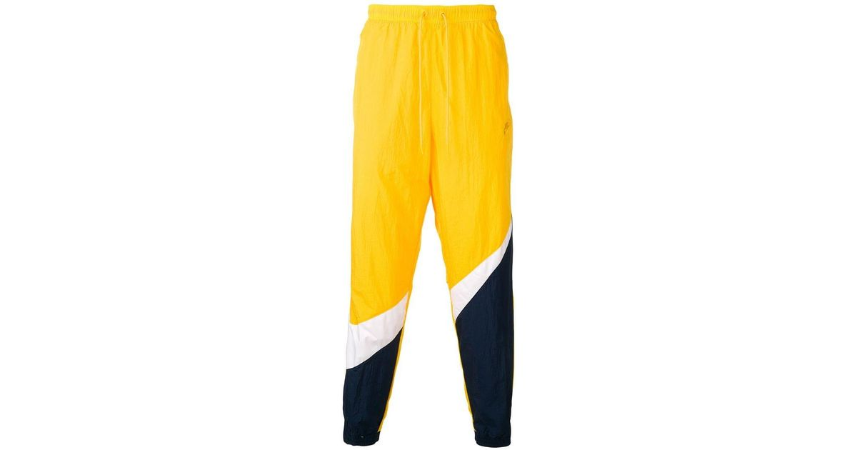 45fd189dac3e Nike Sportswear Track Trousers in Yellow for Men - Lyst