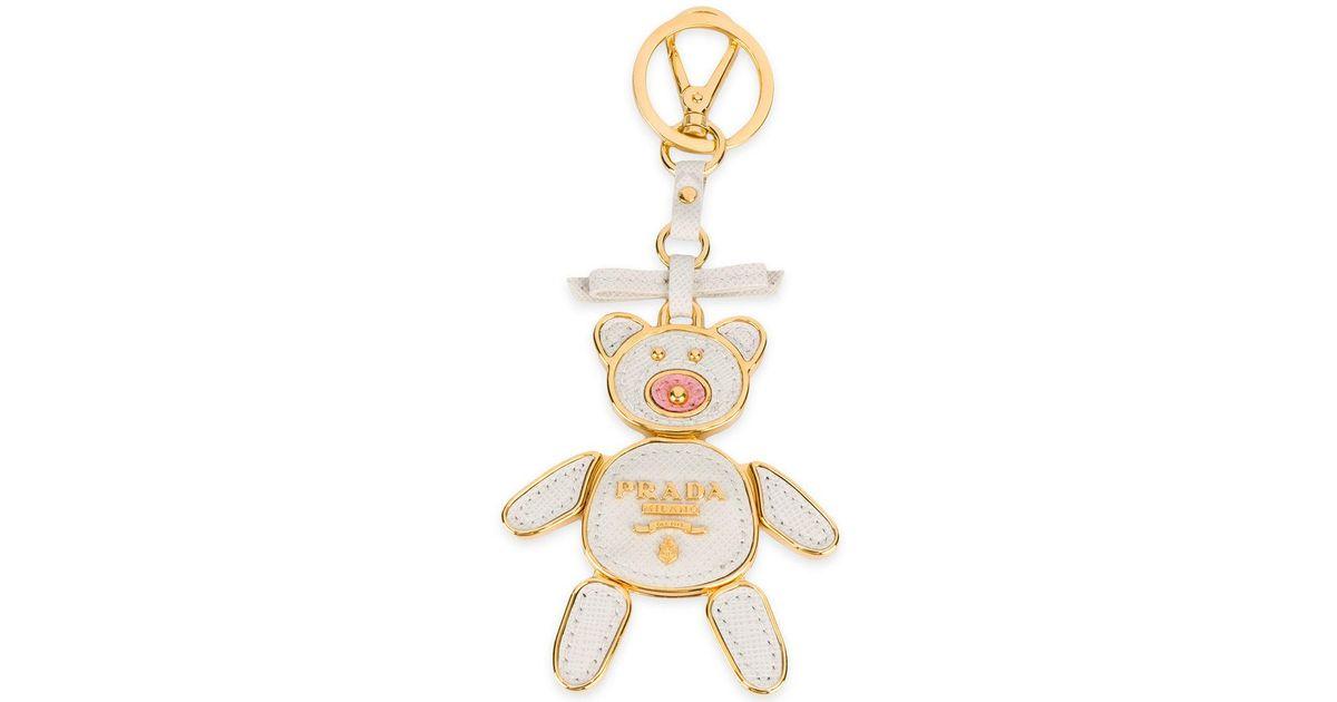 Lyst - Porte-clés nounours à plaque logo Prada en coloris Blanc 8f9d131eb97