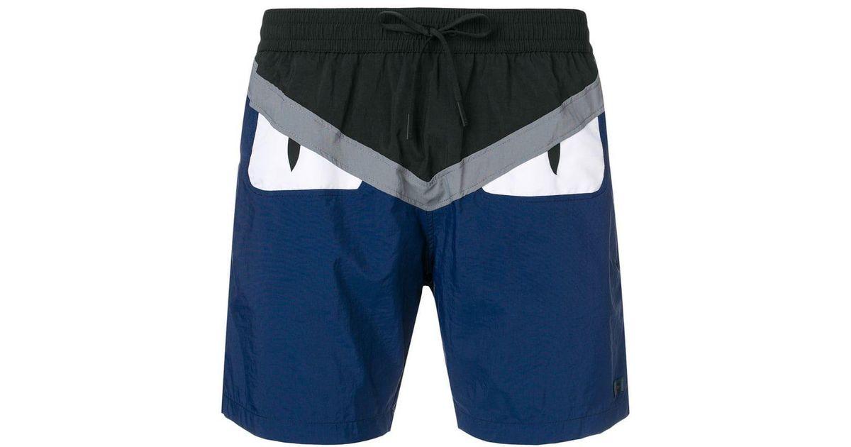 f0318ef9de Lyst - Fendi Bag Bugs Logo Swim Shorts in Blue for Men