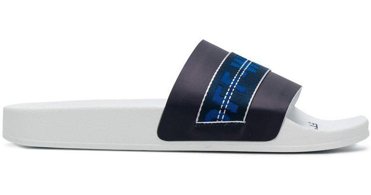 51b2156073a2de Lyst - Off-White c o Virgil Abloh Logo Belt-strap Sliders in Blue for Men -  Save 63%