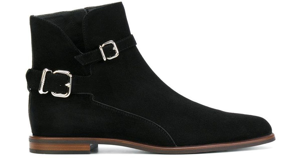 2aa56e6a69b9 Lyst - Tod s Buckle Strap Ankle Boots in Black