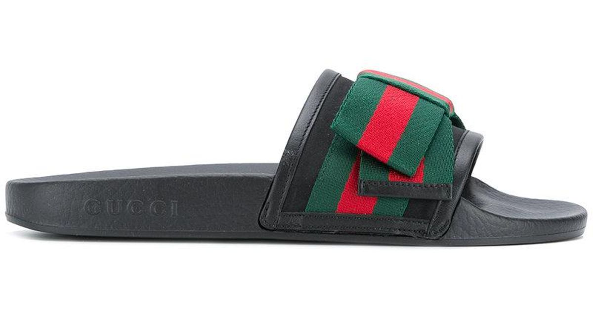 693fe2a7f Gucci Web Bow Slides in Black for Men - Lyst