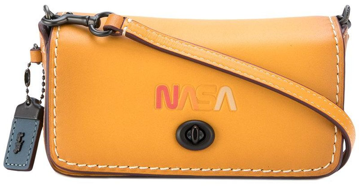 6500b413bb0f Lyst - COACH Embossed Nasa Bag in Orange