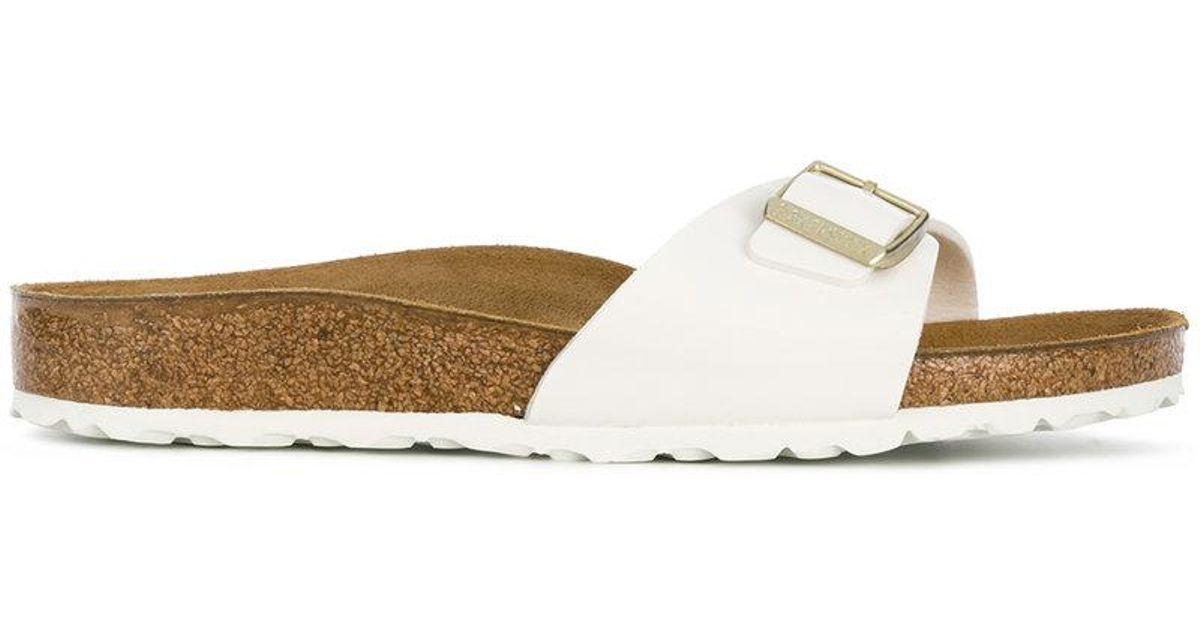 cab086783664 Lyst - Birkenstock Buckle Strap Sandals in White