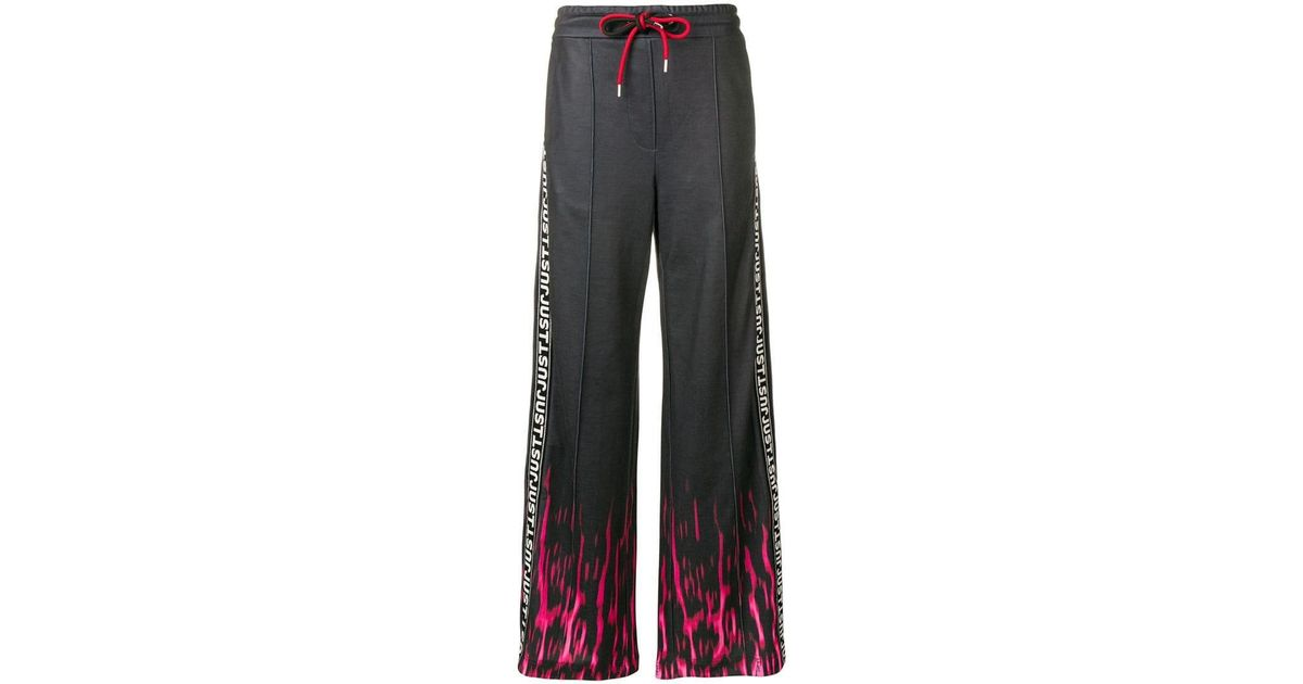 75f4c2ef Just Cavalli Fire Print Track Trousers in Black - Lyst