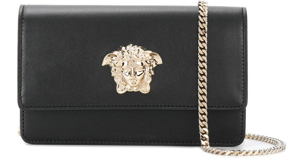 66cb0b911d Lyst - Versace Medusa Foldover Crossbody Bag in Black