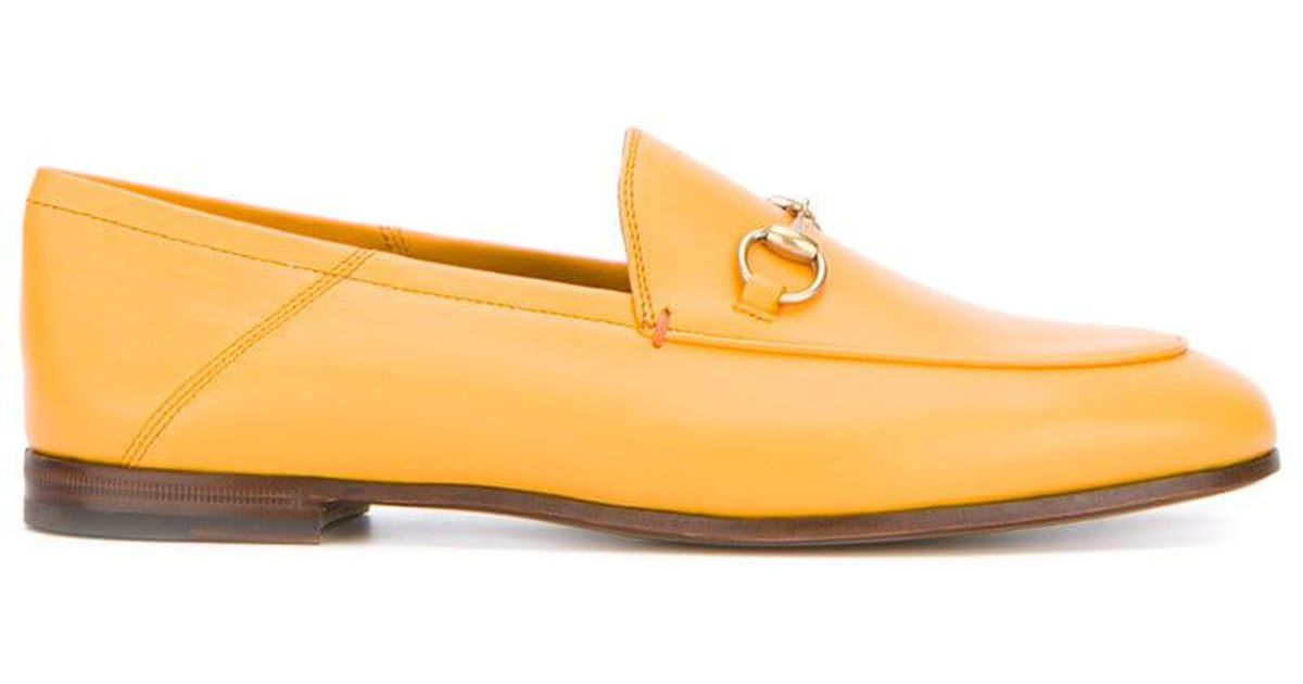 58f8bd68733 Lyst - Gucci Orange Brixton Leather Loafers in Yellow