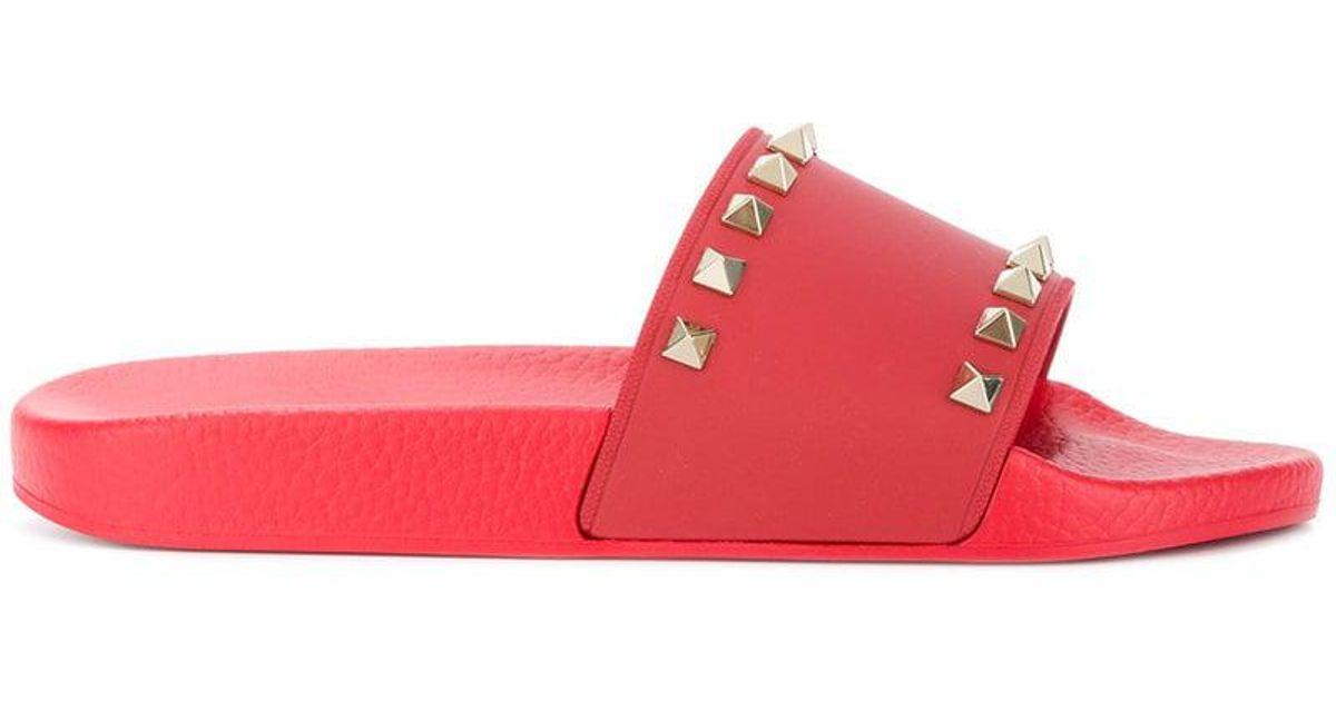 60a86848f31e Lyst - Valentino Rockstud Pvc Sandals in Red