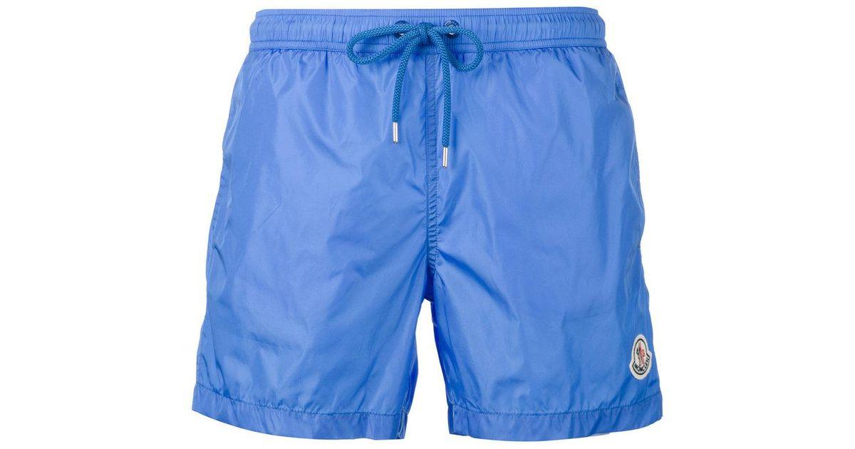 9c57e22b1ea5b Moncler Logo Plaque Swimming Trunks in Blue for Men - Lyst
