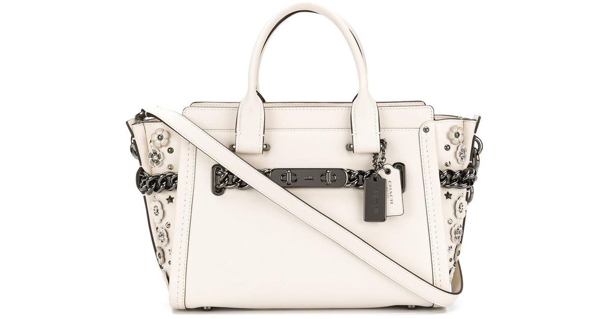 Coach tote bag with floral appliqués in white lyst