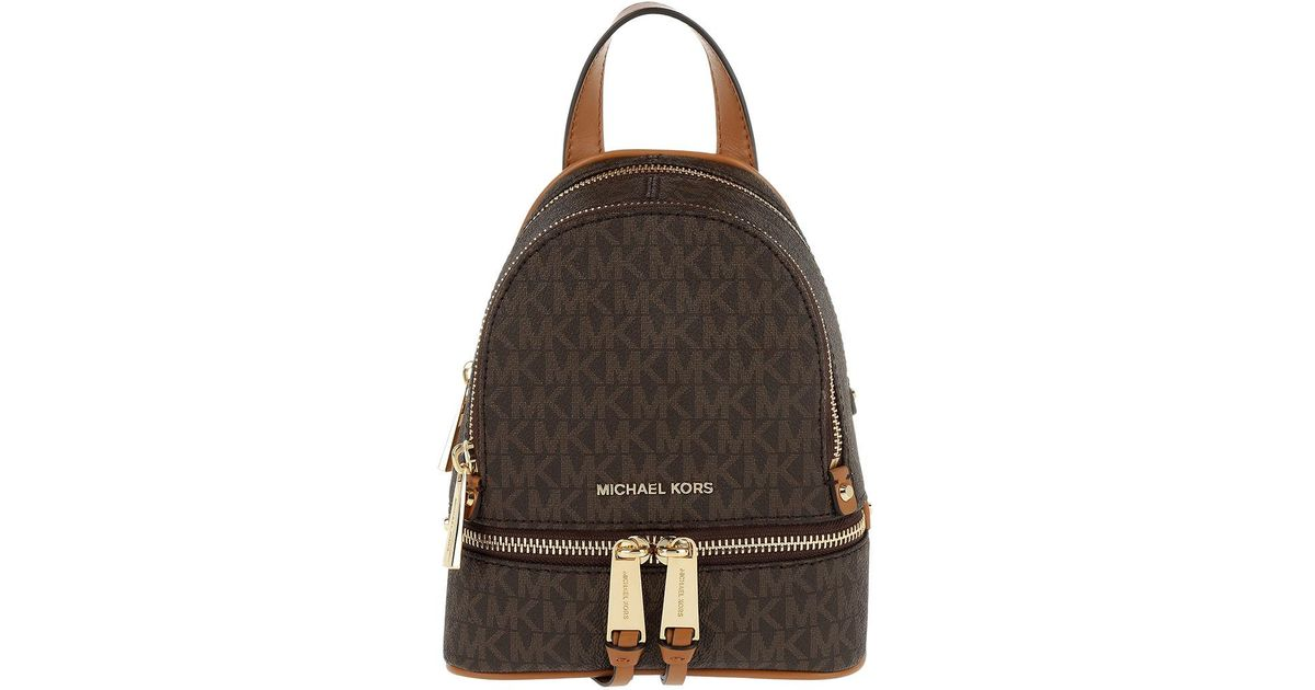 138b837e04ec Michael Kors Rhea Zip Xs Messenger Backpack Brown in Brown - Lyst