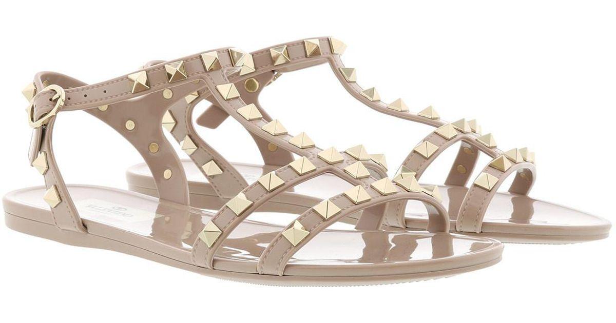 e5fcb1f07394 Valentino Rockstud Flat Sandals Soft Pvc Poudre in Natural - Lyst