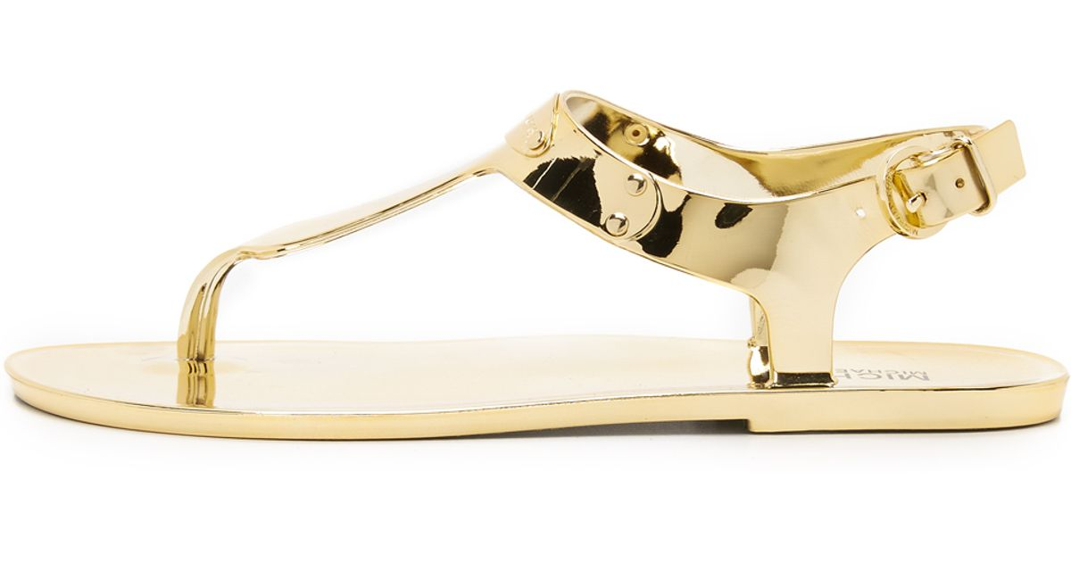 d15e6fd76fff Lyst - MICHAEL Michael Kors Mk Plate Jelly Sandals - Gold in Metallic