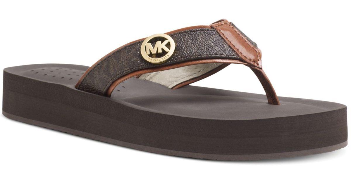 909c45b15fb Lyst - Michael Kors Michael Gage Platform Flip Flops in Brown