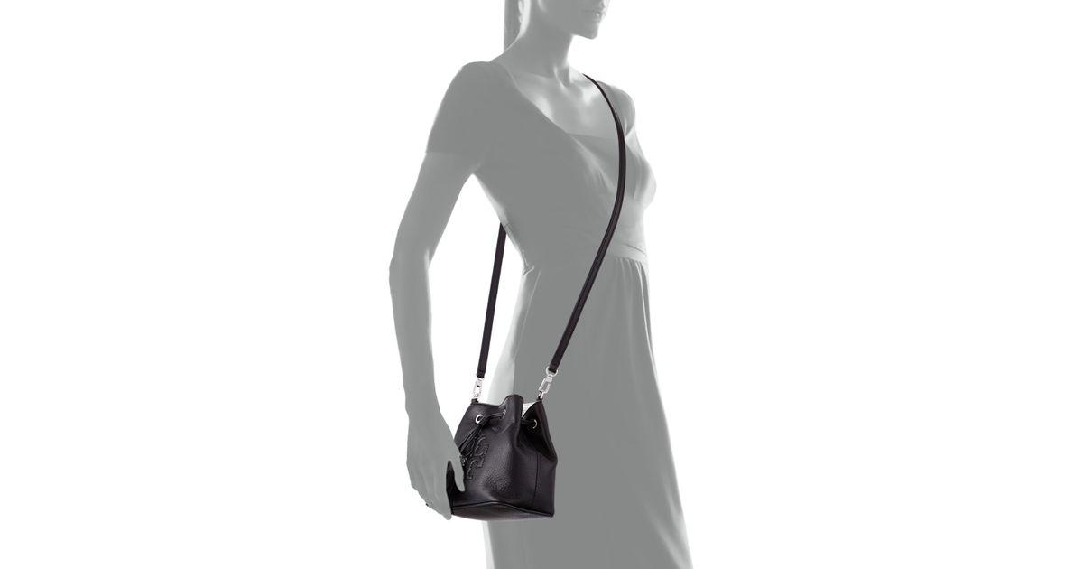 fdc3dc9921d9 Lyst - Tory Burch Thea Mini Crossbody Bucket Bag in Black
