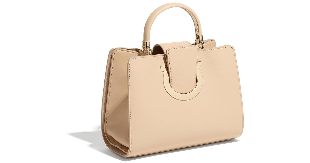 06e296ab73a7 Lyst - Ferragamo Gancini Top Handle Bag in Natural