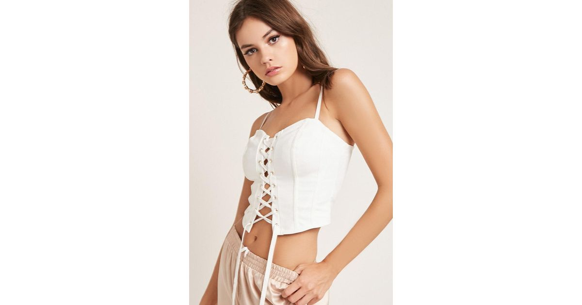 fc09dd495fe Lyst - Forever 21 Lace-up Corset Cami in White
