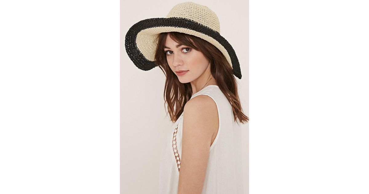 3c9083e9bdc Lyst Forever 21 Striped Floppy Straw Hat In Black. Bow Wide Brim ...