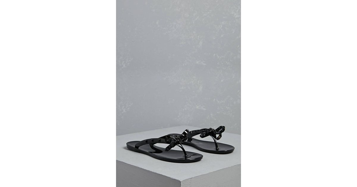 e56a7a0436183 Lyst - Forever 21 Dizzy Studded Bow Jelly Sandals in Black