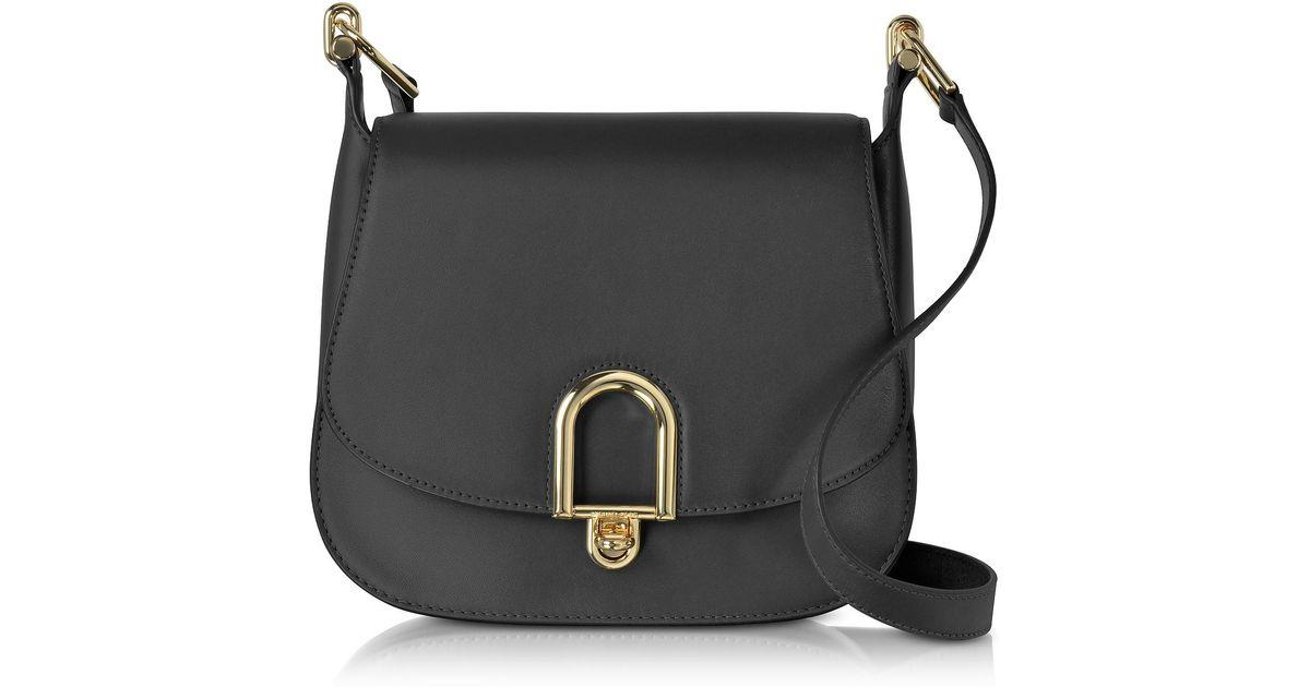 a419e628c25d Lyst - Michael Kors Delfina Large Black Leather Saddle Bag in Black