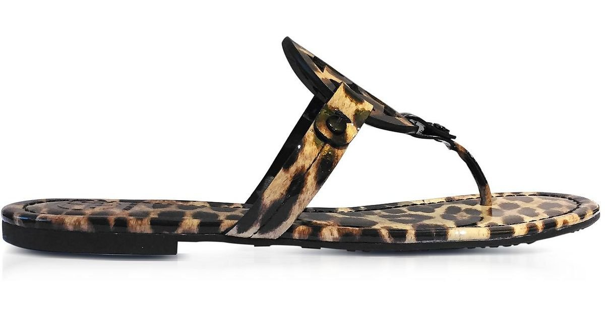 44caab9ce4e37 Lyst - Tory Burch Miller Natural Leopard Print Leather Flat Sandals in Brown
