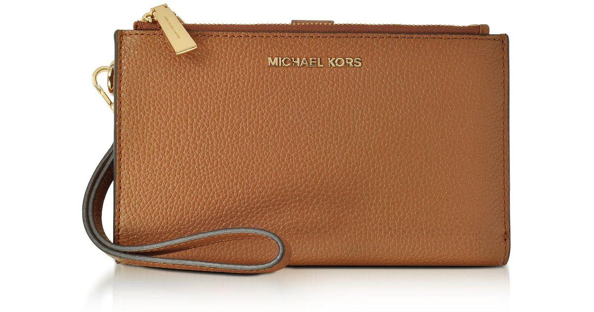 22e3b05b49e6 Lyst - Michael Kors Adele Acorn Pebble Leather Smartphone Wristlet in Brown