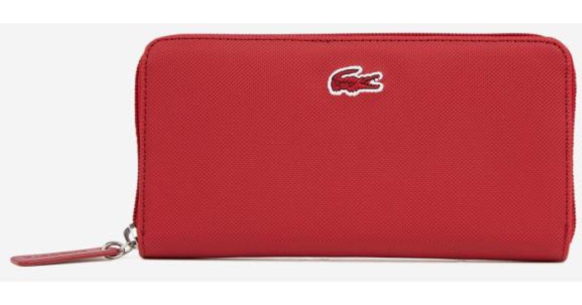 36dbabf761 Lyst - Compagnon zippé Lacoste en coloris Rouge