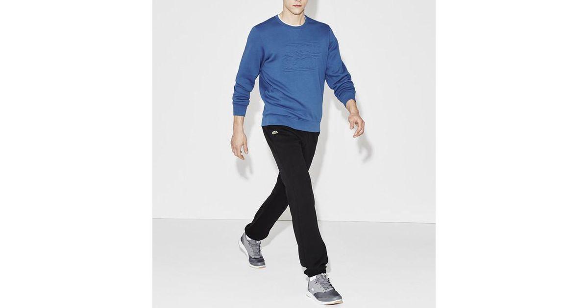 8ac9b16aa2 Pantalon de survêtement en molleton uni Lacoste pour homme en coloris Noir  - Lyst