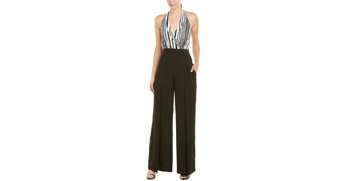 fa53a319afe8 Lyst - BCBGMAXAZRIA Striped Halter Jumpsuit in White
