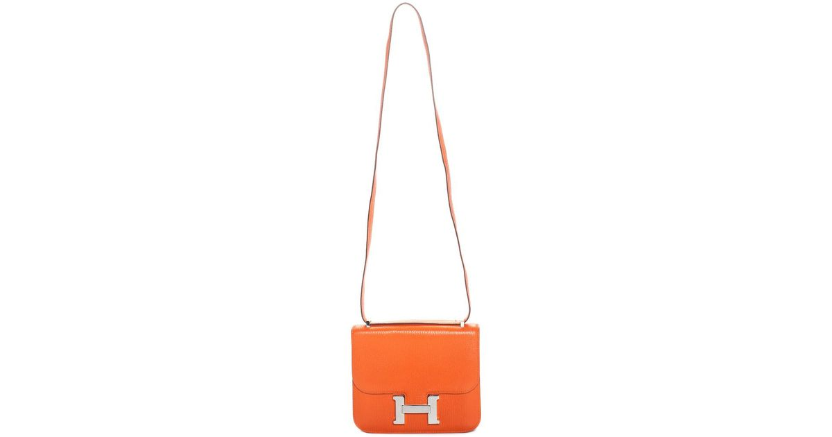 5a2ce8b36b4b Lyst - Hermès Orange Clemence Leather Constance in Orange