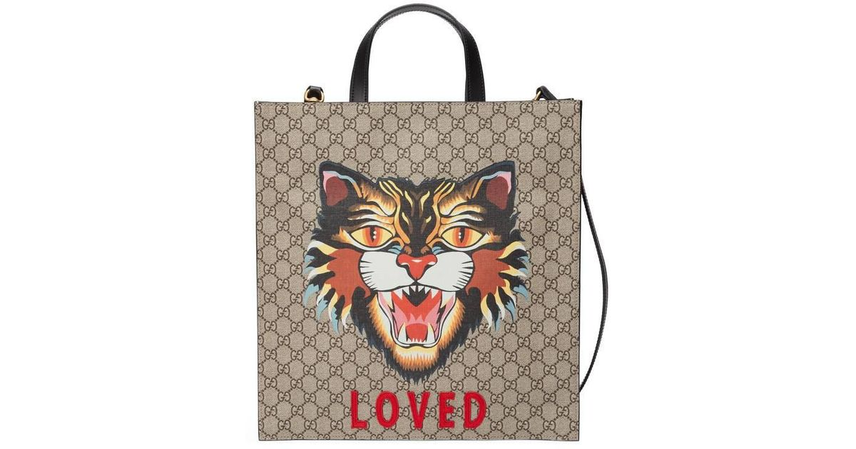 a5e07fed49ef Gucci Angry Cat Print GG Supreme Tote Bag in Natural - Lyst