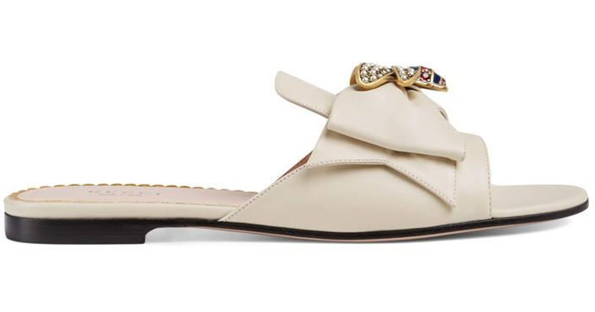 509c2c17ee43b3 Lyst - Gucci Leather Slide With Bow in White