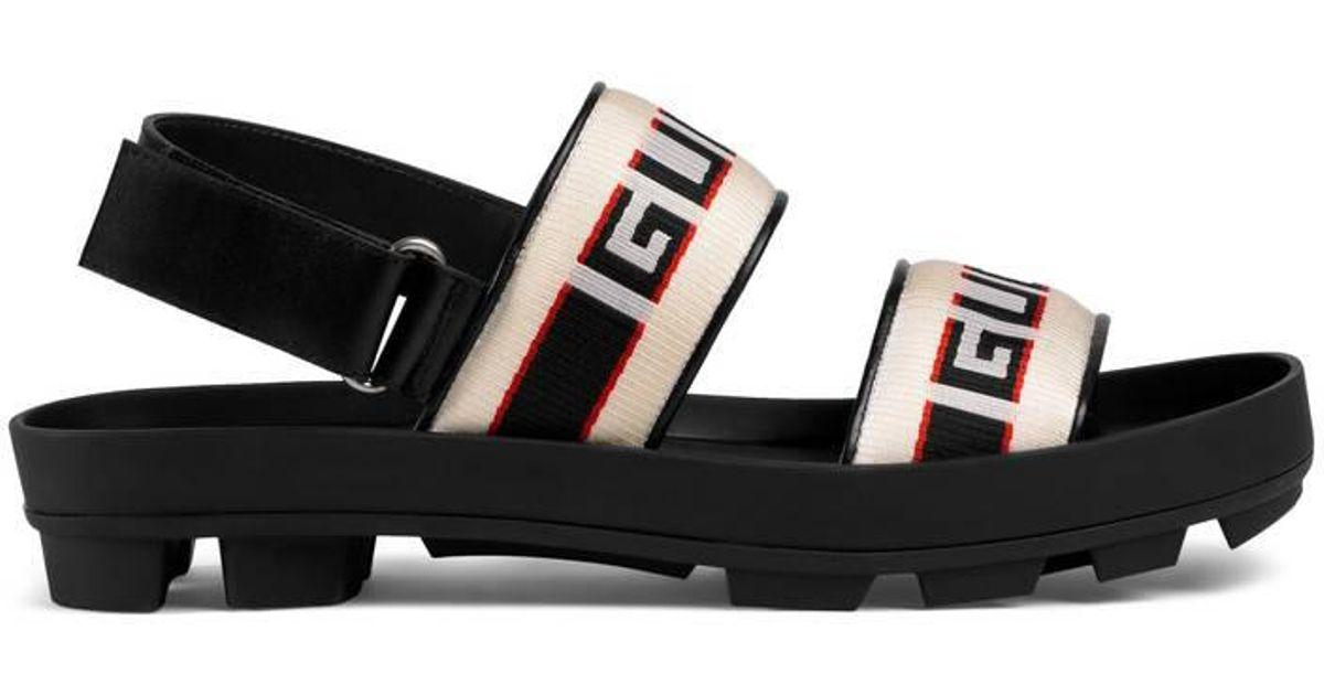 6ce0440a4b77 Gucci Stripe Strap Sandal in Black - Lyst