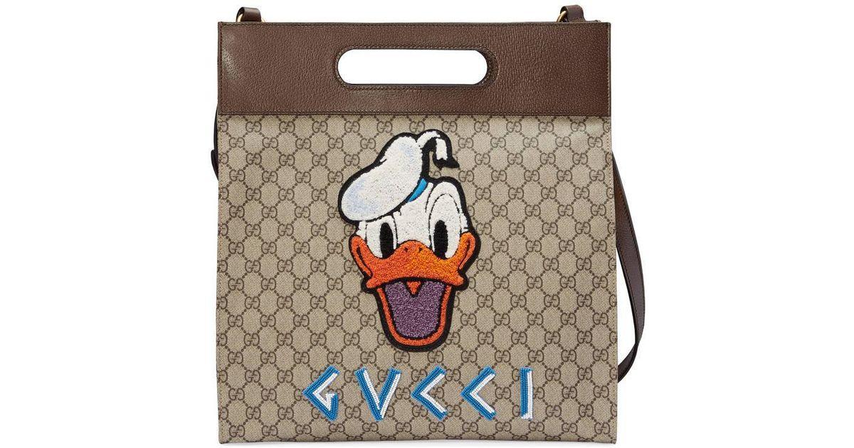 8f35eb53768a Gucci Soft GG Supreme Donald Duck Tote Bag in Natural - Lyst