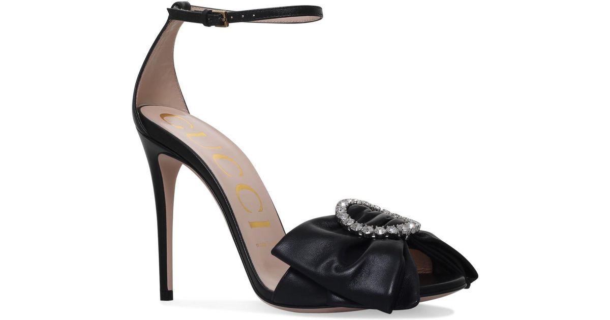 18e3f53368ff Lyst - Gucci Ilse Bow Sandlas in Black