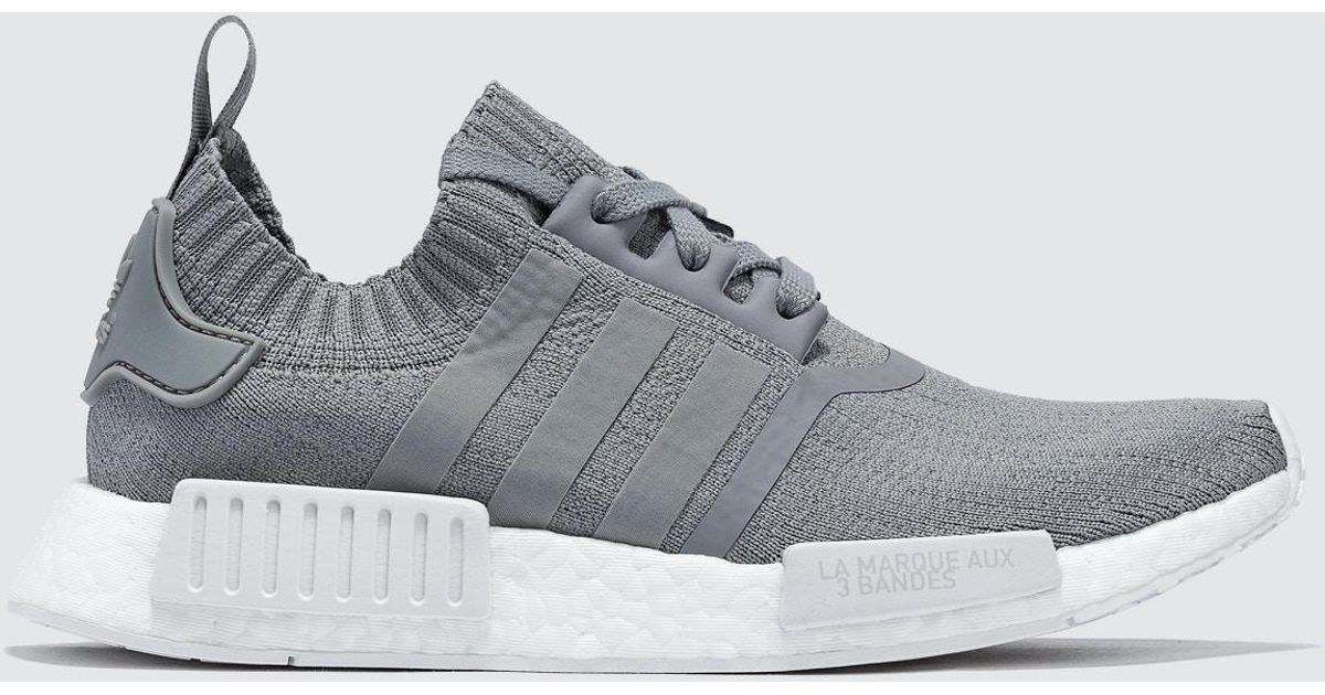 64e18c92f4559 ... top quality lyst adidas originals nmd r1 w pk in gray for men bca9e  1c7ff