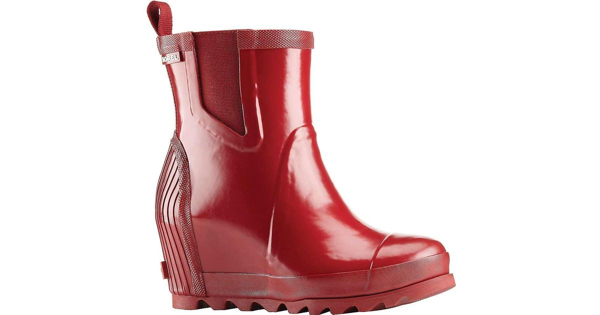 caf35afe8b65 Lyst - Sorel Joan Rain Wedge Chelsea Gloss Boot in Red