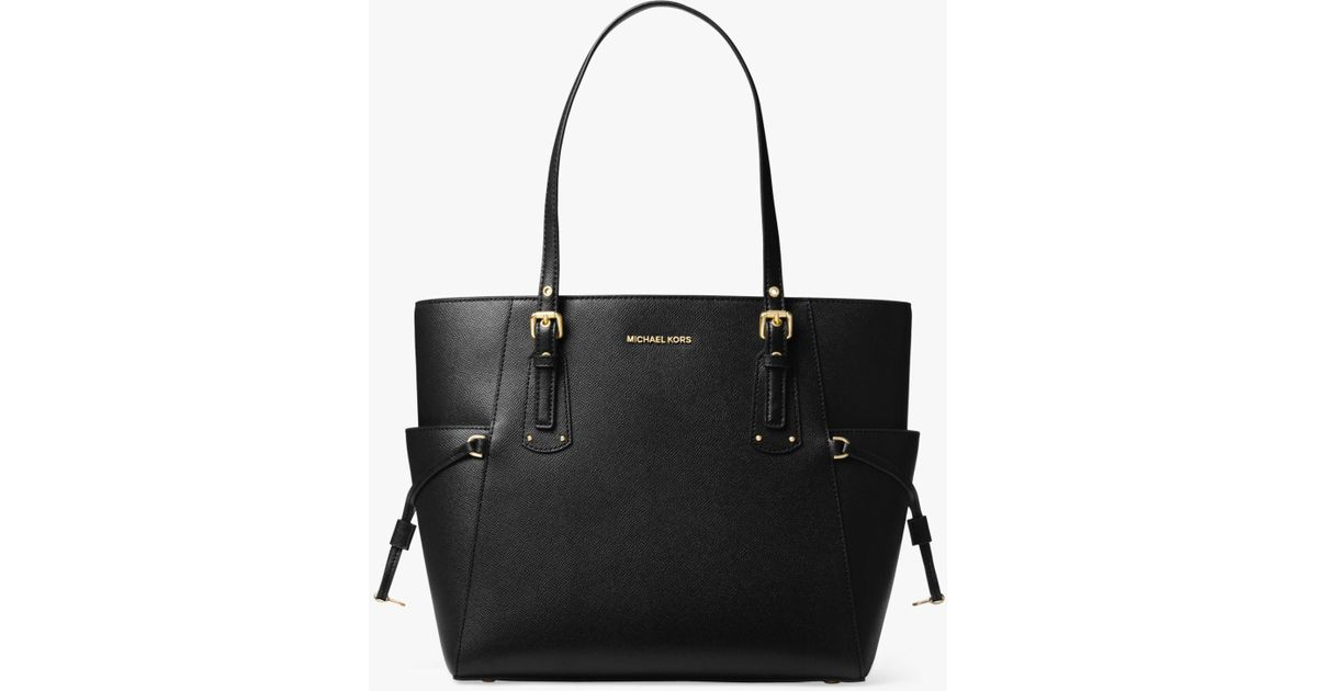 ccaec0ad864a Michael Kors Michael Voyager East West Leather Tote Bag in Black - Lyst