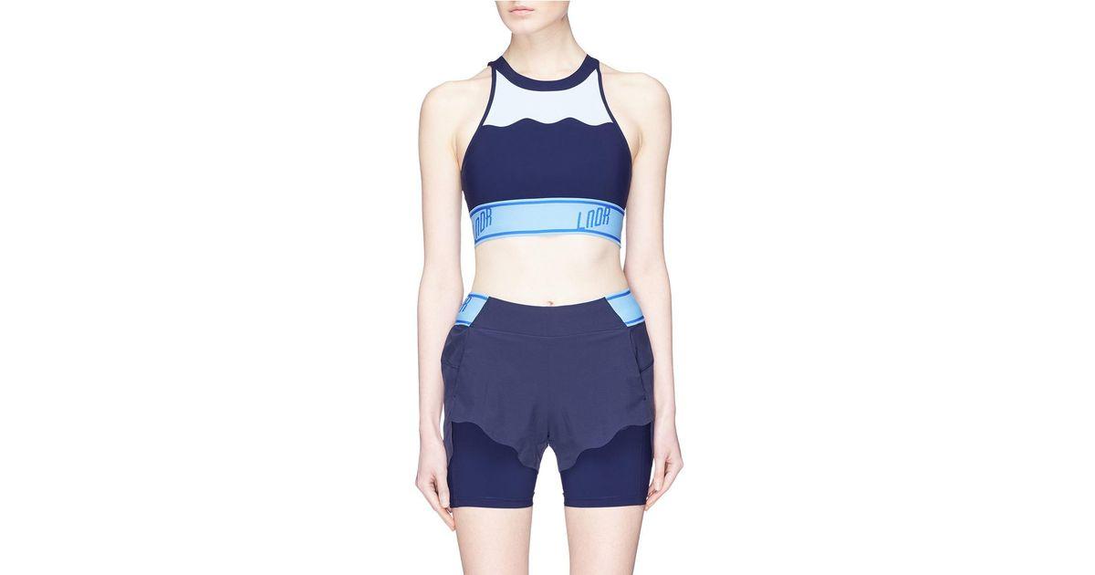 89324b5f087f1 Lyst - Lndr  swell  Cutout Back Colourblock Sports Bra in Blue