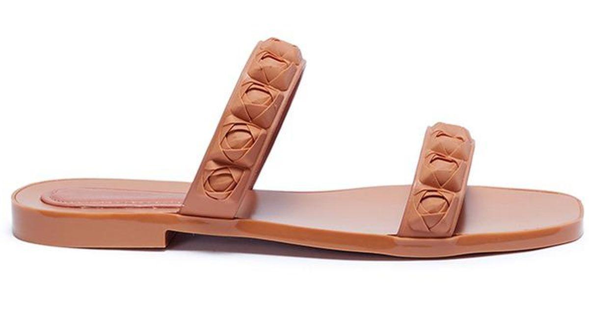 ef423bce88af Lyst - Stuart Weitzman  rosita  Rose Stud Double Band Tpu Slide Sandals in  Pink