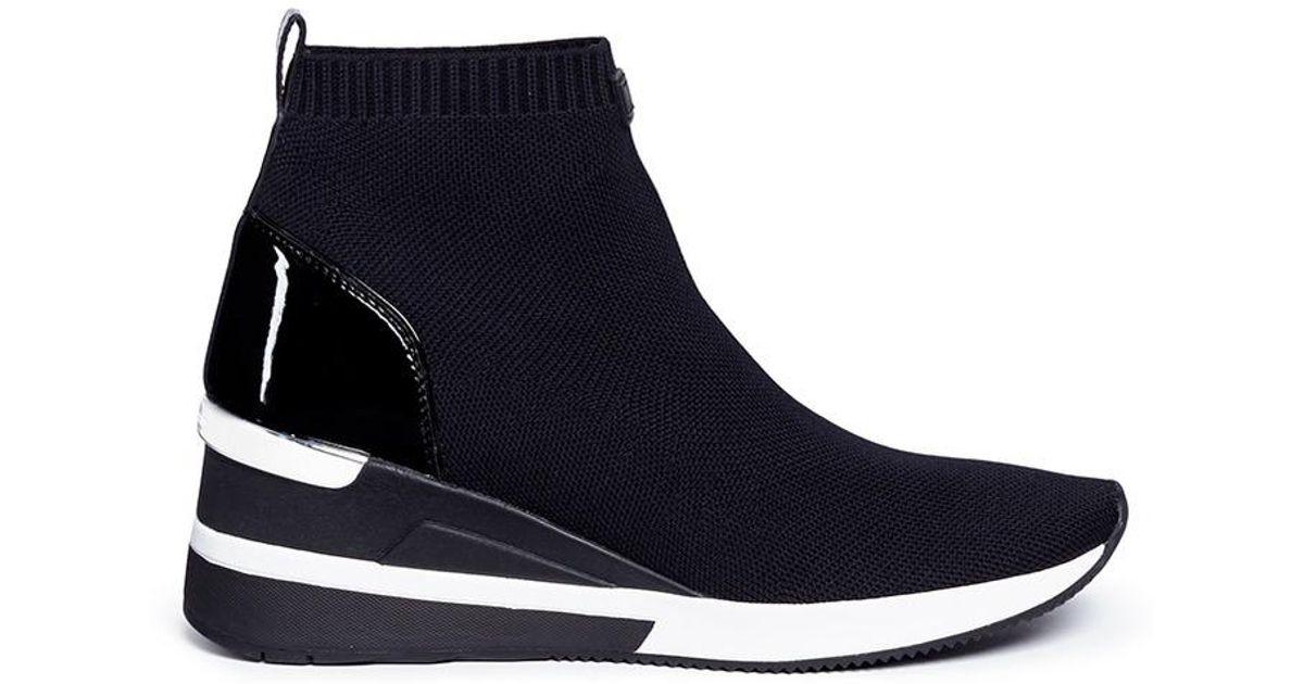 8f9ba198ef51 Lyst - Michael Kors  skyler  Knit Sock Sneaker Boots in Black