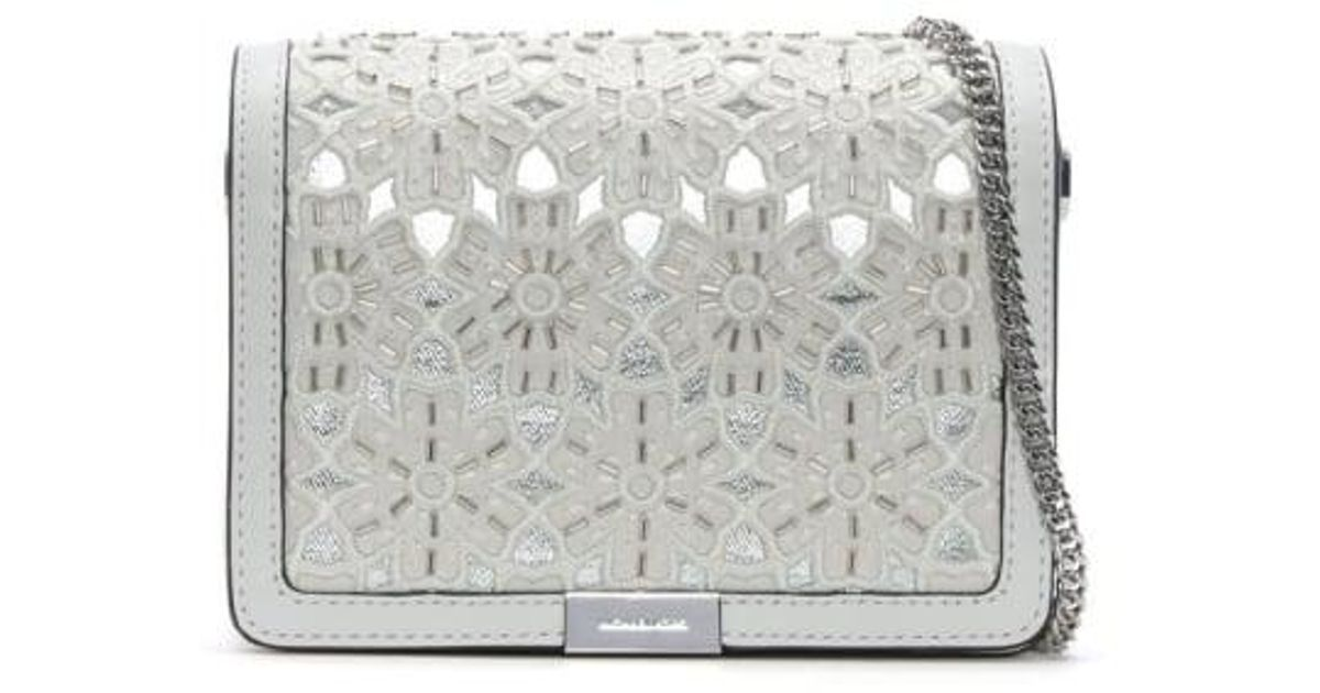 145375d8cff2 ... handbag 34ac4 a337c  get michael kors jade optic white leather floral  clutch bag in white lyst d2842 86353