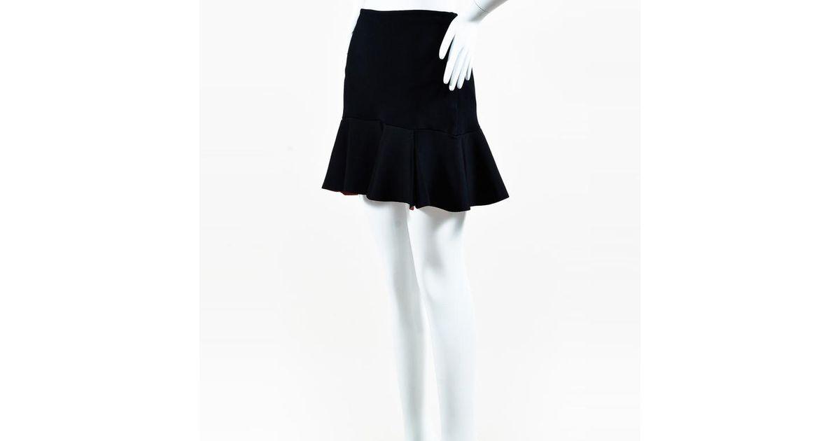 2e7452f1b59c Issa Black Knit Tulip Hem Mini Skirt in Black - Lyst