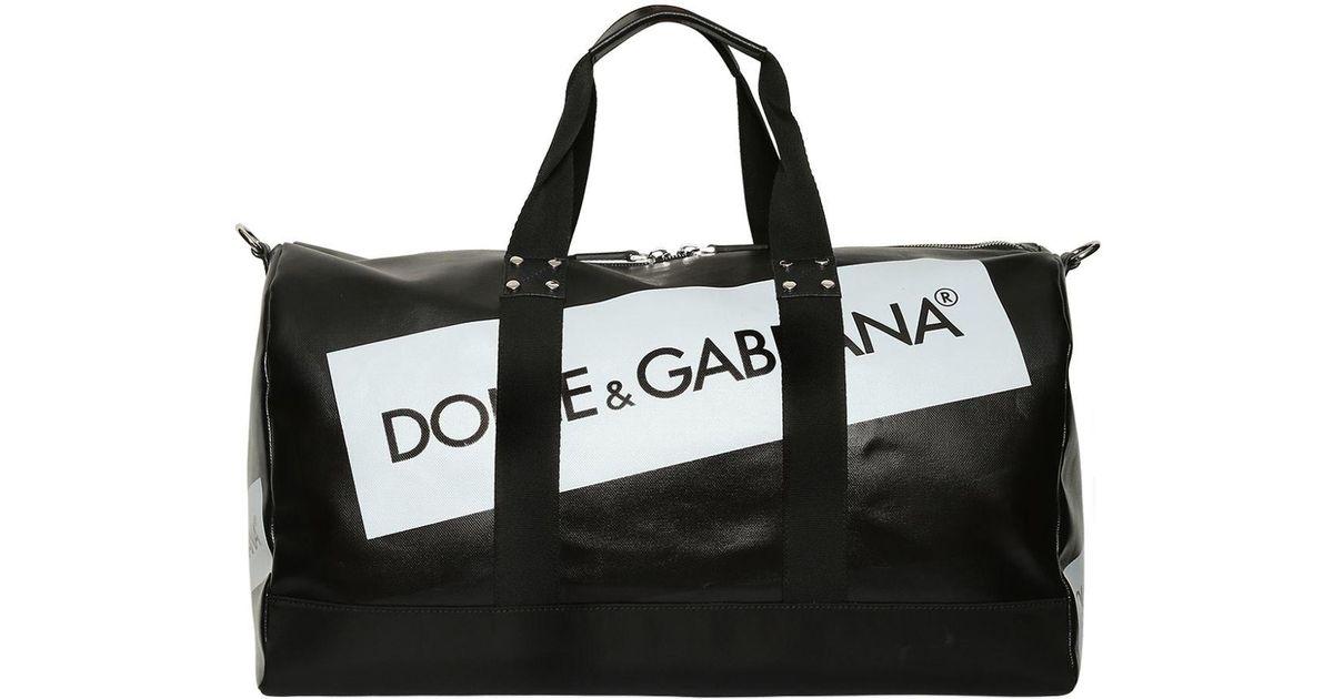 fea876e5f69f Lyst - Dolce   Gabbana Logo Tape Coated Canvas Duffle Bag in Black for Men