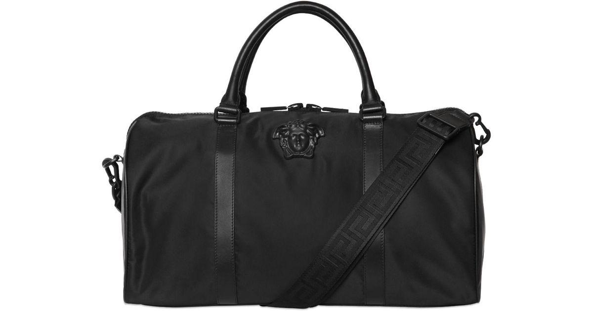 67066114a1b0 Lyst - Versace Medusa Nylon Duffle Bag in Black for Men