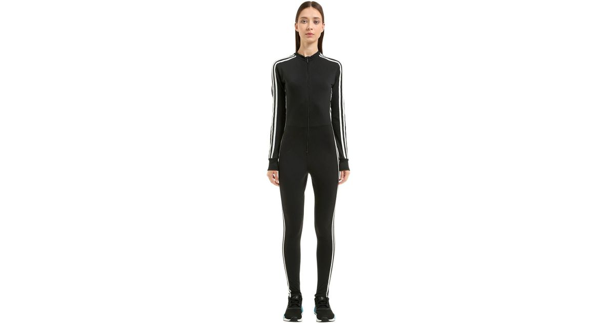 ecdf16bb7097 adidas Originals Stage 3 Stripes Tricot Jumpsuit in Black - Lyst