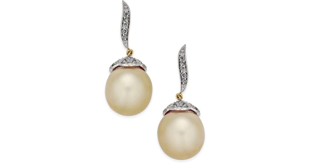 Lyst Macy S Cultured Oval Golden South Sea Pearl 11mm And Diamond 3 8 Ct T W Drop Earrings In 14k Gold Metallic