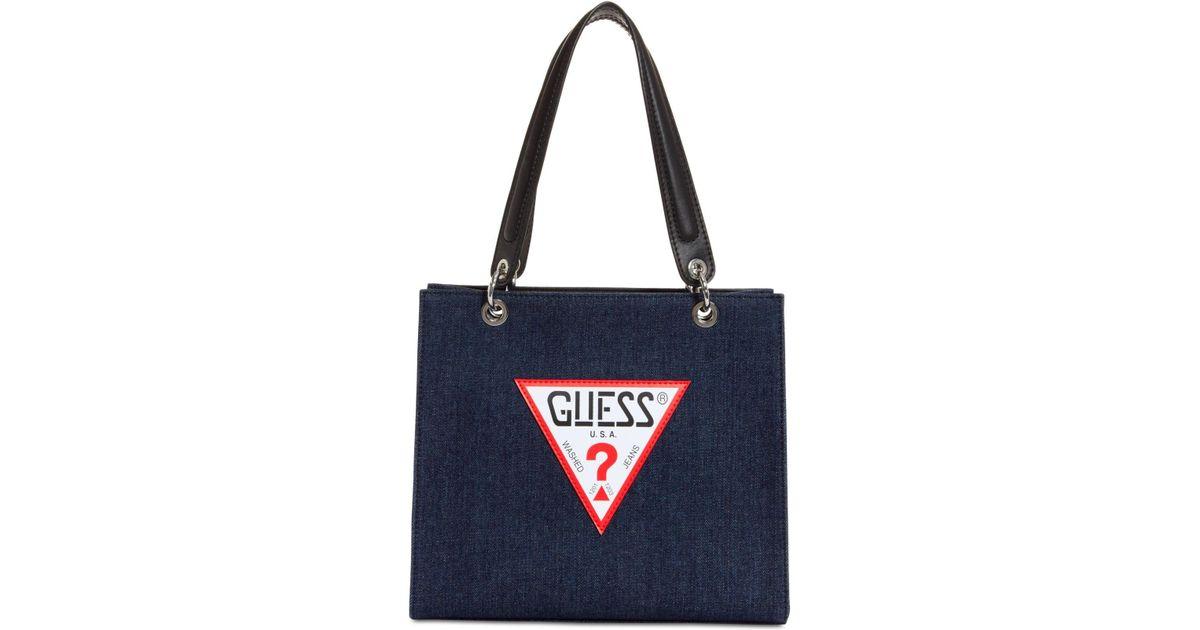 1dc3fe239f81 Lyst - Guess Varsity Pop Denim Logo Tote in Blue